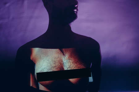 Conceptual image of a tansgender man with woman breast on his chest Stok Fotoğraf