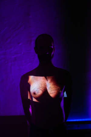 Conceptual image of a tansgender man with woman breast on his chest Stok Fotoğraf - 154753781