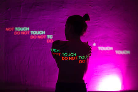 Young adult woman with words Do Not Touch on her body. Sexual harassment concept Stok Fotoğraf