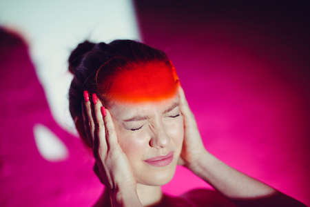 Young woman with headache and red color forehead Stok Fotoğraf