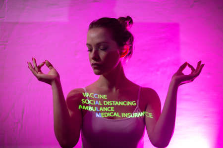 Young adult woman with word Calm composed of words Vaccine Social Distance Ambulance and Medical Insurance on her body Stok Fotoğraf