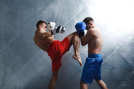 Two men boxers fighting muay thai boxing