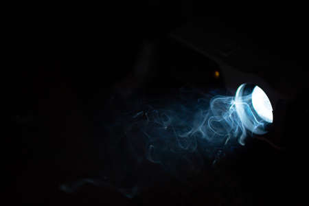 Film projector light ray with smoke in darkness