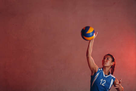 Young woman smiling volleyball player with ball Stok Fotoğraf