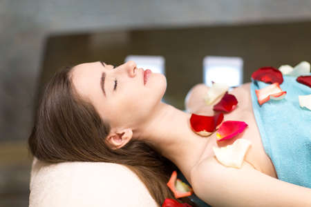Young beautiful woman relaxing in beauty spa after massage Stok Fotoğraf