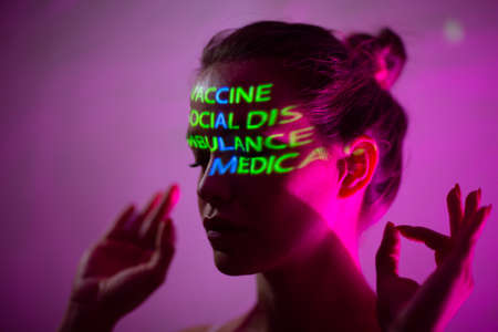 Young adult woman with words Calm composed of words Vaccine Social Distance Ambulance and Medical Insurance on her face