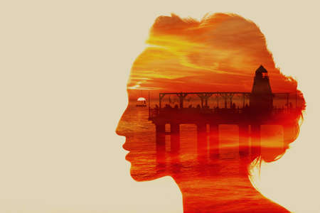 Woman with sun, lighthouse and clouds in her head.