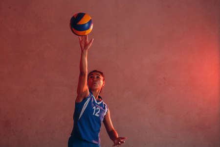 Young asian woman smiling volleyball player with ball Standard-Bild