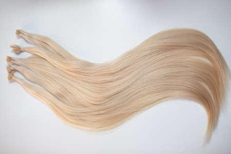Micro Beads Nano Ring Human Hair Extensions on white background Standard-Bild