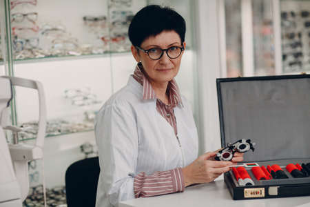 Optometrist Woman Optician wih Ophthalmic Test Lens Kit.