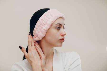 A beautiful young woman portrait in pink cosmetic bandage towel on her head Stok Fotoğraf