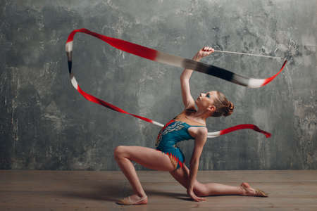 Young girl professional gymnast woman dance rhythmic gymnastics with ribbon at studio Stok Fotoğraf