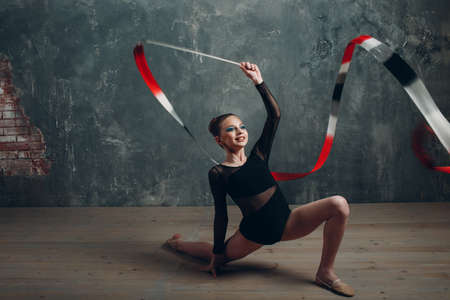 Young girl professional gymnast woman rhythmic gymnastics with ribbon at studio Stok Fotoğraf