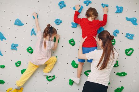 Kid child at climbing wall. Children sport, healthy lifestyle in kindergarten or sport center in school