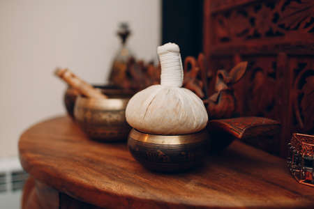 Herbs bag accessories for thai massage procedure at beauty spa Foto de archivo