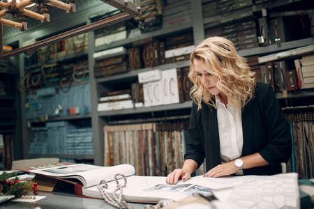 Interior designer woman at work. Design and interior decoration workspace