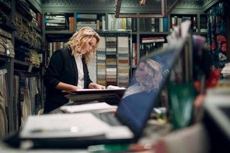 Interior designer adult woman at work. Design and interior decoration. Foto de archivo