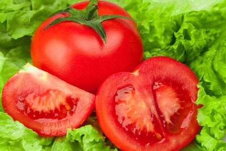 Beautiful piece tomato with salad background photo
