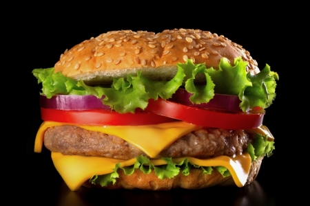 Beautiful and juicy burger close-up on black background. Food is a series of fast-food.