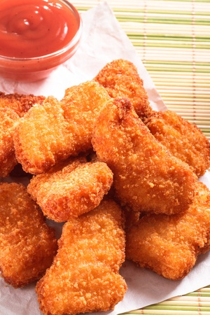 Several pieces of fresh and delicious chicken nuggets Imagens