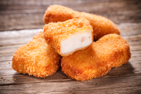 Nuggets on Wood Background photo