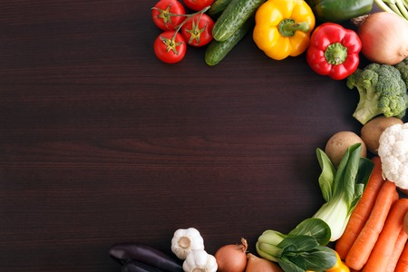 Vegetables on wood background with space for recipe. Organic food. photo