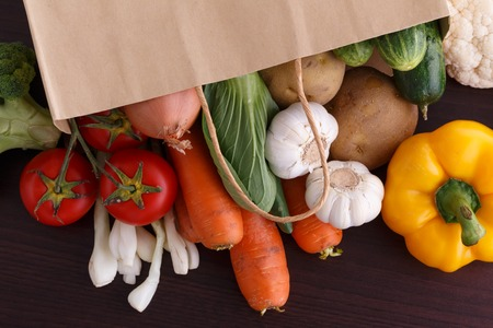 Vegetables on wood background with space for recipe. Organic food.