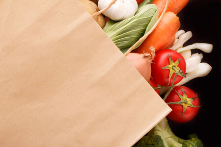 Vegetables in the box on wood background with space for text. Organic food. photo