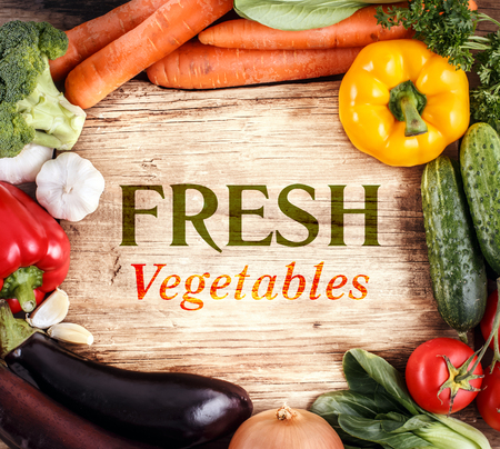 Vegetables on wood background with space for text. Organic food. photo
