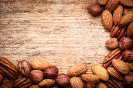 mixed nuts: Background texture of assorted mixed nuts including cashew nuts, pecan nuts, almonds