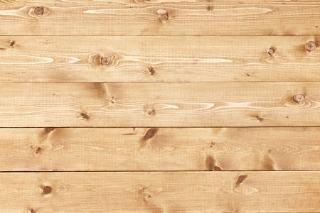 Architectural background texture of a panel of natural unpainted pine board cladding with knots and wood grain in a parallel pattern conceptual of woodwork, carpentry, joinery and construction Banco de Imagens