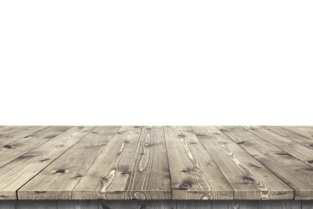 floorboards: Empty wooden table in a sun drenched summer garden for product placement or montage with focus to the table top in the foreground, with white background.