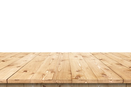 product placement: Empty wooden table in a sun drenched summer garden for product placement or montage with focus to the table top in the foreground, with white background.