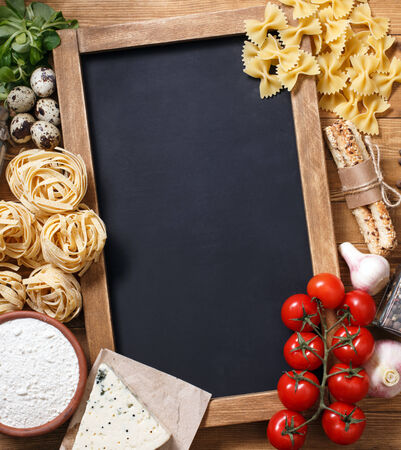 Italian food on vintage wood background, with chalkboard, with copyspace 스톡 콘텐츠