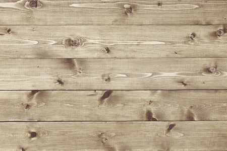 Architectural background texture of a panel of natural unpainted pine board cladding with knots and wood grain in a parallel pattern conceptual of woodwork, carpentry, joinery and construction Stock Photo