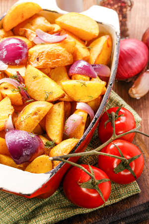 indulgence: Rustic Fried Potato and fresh vegetables. Close-up Stock Photo