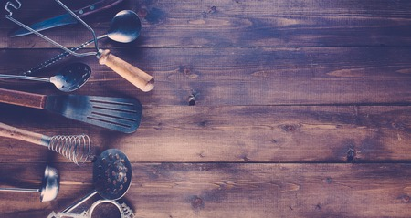 old items: Vintage kitchen items on old wooden background. Stock Photo