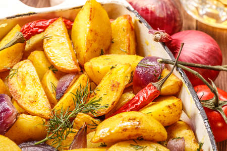 indulgence: Roast potatoes with fresh vegetables on the rustic