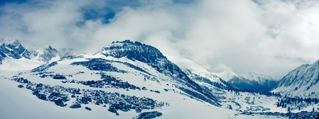 mountain: Winter landscape of mountains. Snow-covered mountains. Beautiful mountain landscape.