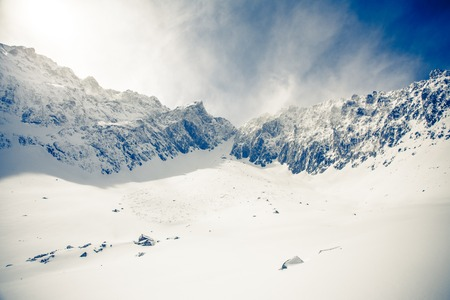 Winter landscape of mountains. Snow-covered mountains. Beautiful mountain landscape.