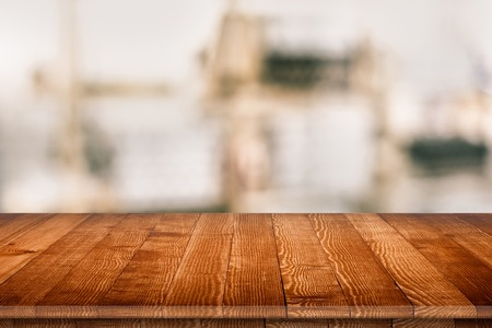 Wooden tabletop perspective for product placement or montage with focus to table. Wooden board surface. Stock Photo
