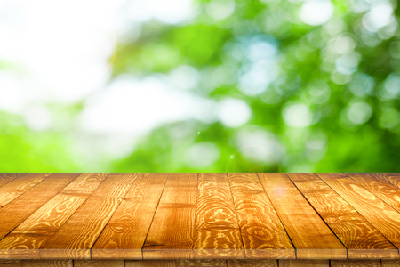 Rustic wooden table vintage style in perspective view for product placement or montage with focus to table. Wooden board surface.