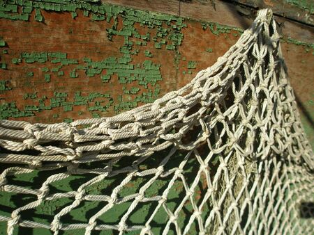 grey net hanging on peeled off wall Stock Photo - 2766042