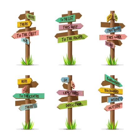Gekleurde houten pijlborden richting vector set. Houten teken postconcept met gras. Board pointer illustratie met tekst geïsoleerd op een witte achtergrond Stock Illustratie