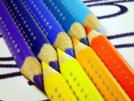 Beautiful crayons on white paper with numbers