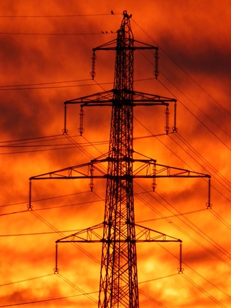 kw: Elctric mast of 400 Kw power with birds on early morning Stock Photo