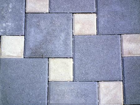Yellow and gray paver