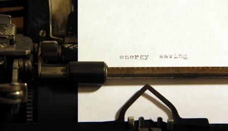 Energy saving words on old typewriter. Stock Photo