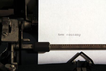 New economy words concept on old typewriter. photo