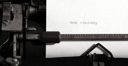 New economy concept on old typewriter. photo